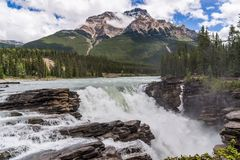 Athabasca Falls with cloudy sky stock photos