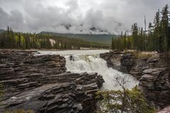 Athabasca falls on a wet rainy day. The majestic Athabasca falls on a wet rainy day (Jasper Alberta Canada Royalty Free Stock Images