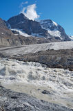 Athabasca Glacier with melt water 02. Athabasca glacier with melt water, Mount Andromeda in the background Royalty Free Stock Images