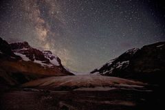 Athabasca Glacier Milky Way. Athabasca Glacier in Jasper National Park with the Milky Way Galaxy in the background, a satellite and one meteor royalty free stock photography