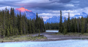 Athabasca River at Sunset with Rocky Mountains in Background Stock Images
