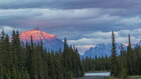 Athabasca River at Sunset with Rocky Mountains in Background Stock Image