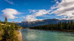 The Athabasca River. Viewed from the Maligne Road bridge. The Whistlers mountain near the town of Jasper in the background royalty free stock photography