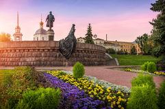 Athanasius Nikitin in Tver. Monument and the temple on the background of pink sunset sky Stock Photos