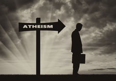 Atheist men stands near road sign Atheism Royalty Free Stock Photography