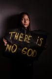 Atheist teen girl holding a banner with the inscription Royalty Free Stock Image