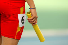 Athelete on a relay event Stock Photo