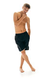 Atheletic man in shorts. Isolated on white background Stock Images