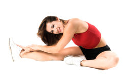 Atheletic Stretch. A woman stretches before her work out in the gym Stock Photo