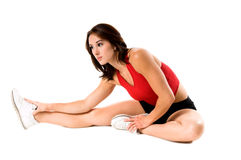 Atheletic Stretch. A woman stretches before her work out in the gym Stock Image