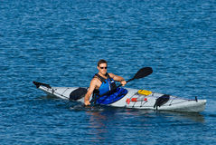 Atheltic man in a sea kayak Royalty Free Stock Photos