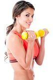 Atheltic woman holding weights Stock Photography
