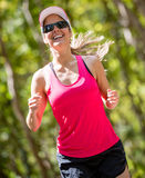 Atheltic woman running Stock Image