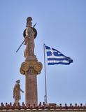 Athena and Apollo statues and Greek flag Stock Photos