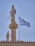 Athena and Apollo statues and Greek flag Stock Image