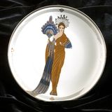 Athena erte plate square. Erte art deco collectible tiara plate on black velvet background the Athena showing a lovely woman in a gold gown holding a blue fan stock photos