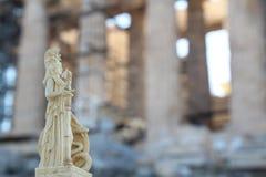 Athena in front of Parthenon. The Parthenon /ˈpɑːrθəˌnɒnˌ -nən/; Ancient Greek: Παρθενών; Modern Greek royalty free stock photo