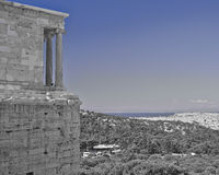 Athena Nike ancient temple over Athens cityscape, Greece. In b/w and blue Stock Photography