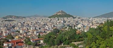 Athene en zet Lycabettus, Griekenland op Stock Foto's
