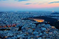 Athene met het oude olympische stadion stock foto