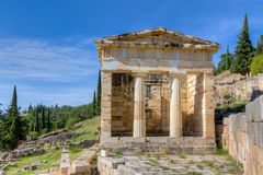 Athenian treasury, Delphi, Greece. The Athenian Treasury at Delphi constructed by the Athenians to house dedications made by their city and citizens to the Royalty Free Stock Images