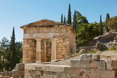 The Athenian treasury in Delphi, Greece in a summer day. royalty free stock image