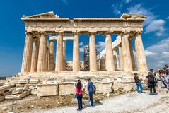 People visit the Ancient Greek Parthenon on the Acropolis of Athens, Greece. Athens – May 8, 2018: People visit the Ancient Greek Parthenon on the stock photography