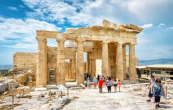 People visit the Ancient Greek Propylaea on the Acropolis of Athens, Greece. Athens – May 8, 2018: People visit the Ancient Greek Propylaea on the stock photos