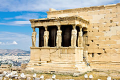 Athens Acropolis, The Erechtheum. Greece, Athens, Acropolis archaeological site of the Erechtheum porch of the Caryatids with Athens city in the background Royalty Free Stock Photography