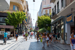 ATHENS-AUGUST 22: People shop on Ermou Street on August 22, 2014 in Athens, Greece. Stock Photo