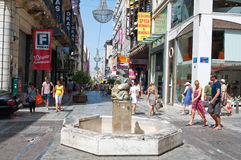 ATHENS-AUGUST 22: Shopping on Ermou Street with crowd of people on August 22, 2014 in Athens, Greece. Royalty Free Stock Photos