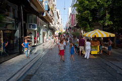 ATHENS-AUGUST 22: Shopping on Ermou Street with crowd of people on August 22, 2014 in Athens, Greece. Stock Photography
