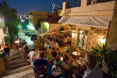 ATHENS-AUGUST 22: Street with various restaurants and bars on Plaka area, on August 22, 2014 in Athens. royalty free stock photo