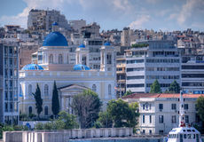 Athens city, Greece. Athens, Greece - September 23, 2015. View of the capital of Greece Athens from the port. In the foreground with a typical greek church Stock Photo