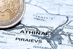 Athens and Euro coin. Concept studio shot depicting current economic issues surrounding the Greek economy and the Euro Stock Images