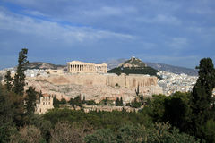 Athens, Greece. View of the Acropolis and the Parhtenon.  The hill of Lykavitos can be seen in the background with St.George church on top Royalty Free Stock Images
