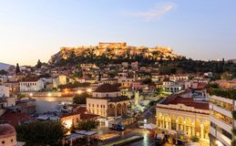 Athens, Greece. Acropolis rock and Plaka early in the morning. Athens, Greece. Illuminated Acropolis rock and Plaka at sunrise, blue sky background stock photography