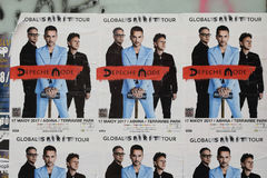 Depeche mode concert posters. ATHENS, GREECE - APRIL 24, 2017: Wall with Depeche Mode concert posters. Advert for pop music group world tour Royalty Free Stock Images
