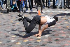 Young man breakdancing. ATHENS, GREECE - APRIL 1, 2018: Young man breakdancing in public square. Urban street dance youth culture Royalty Free Stock Photo
