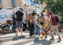 Athens Greece/August 17, 2018: Homeless man with cart in Athens royalty free stock image