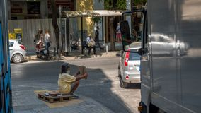 Athens Greece/August 17, 2018: Woman walking down closed down fl stock photo