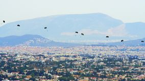 Parachutists in action. Athens, Greece - 05.03.2018: Chinook Helicopter Launches A Group Of Paratroopers During A Training Exercise Over The Tatoi Military