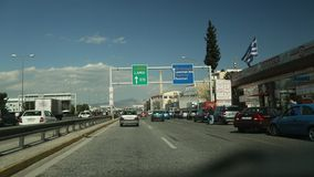 ATHENS, GREECE - CIRCA APR, 2015: Driving on a highway in Athens, view through front windshield. Going on the overpass. stock video footage