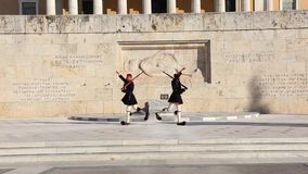 Greek evzones - greek tsolias - guarding the presidential mansion in front of the tomb of the unknown soldier stock footage