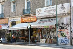ATHENS, GREECE - JULY 18, 2018: buildings and stores on streets stock photo