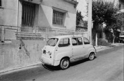 1980 Vintage black and white photography of a Fiat Multipla 600. ATHENS, GREECE - JULY, 1983: Rugged old Fiat 600 Multipla from the 1960`s, missing some original royalty free stock images