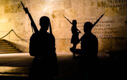 Athens, Greece - May 11, 2016: Figure silhouette of guards Evzones at night in front of the Monument of the Unknown Soldier. Near the Greek parliament in Athens