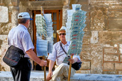 ATHENS - GREECE - MAY 27, 2006 Sellers of lottery tickets. Lottery ticket vendors are located throughout the city of Athens. Here a small rest next to the church royalty free stock photography