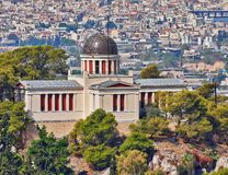 Athens Greece, the national observatory neoclassical building on Nymphs hill. Athens Greece, the national observatory neoclassical vintage building on Nymphs Royalty Free Stock Photography