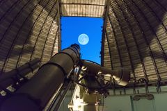 Athens, Greece 5 November 2016. Big telescope against the full moon at Penteli observatory Stock Photography